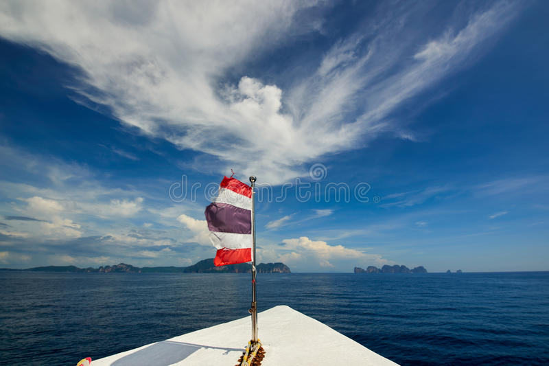 Thailand flag with boat sails to Koh Phi Phi island, Thailand. XXL stock image