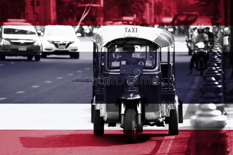 Thailand flag overlay on Tuk Tuk picture, it is a three-wheeled motorized vehicle used as a taxi are waiting and find for royalty free stock photos