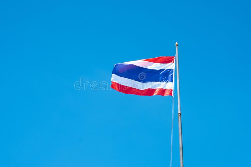 Thailand flag waving in the wind with beautiful blue sky.  stock images