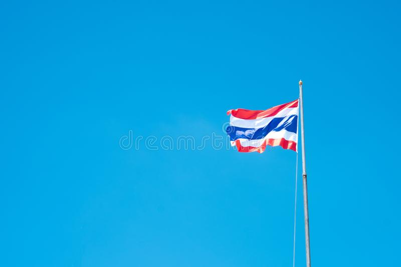 Thailand flag waving in the wind with beautiful blue sky.  royalty free stock photo