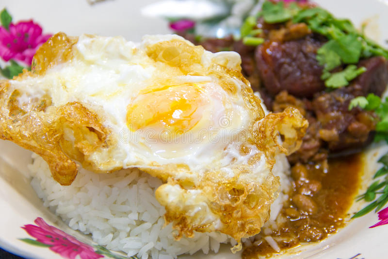 Thailand food,Pork fried. With rice and fried egg royalty free stock photography