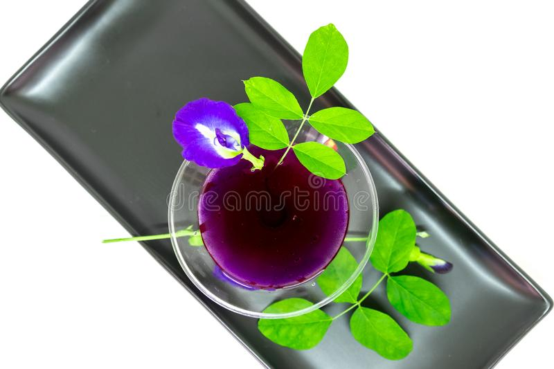 Thailand fresh healthy herbal beverage An-chan juice with lemon juice butterfly pea floweron white background royalty free stock image