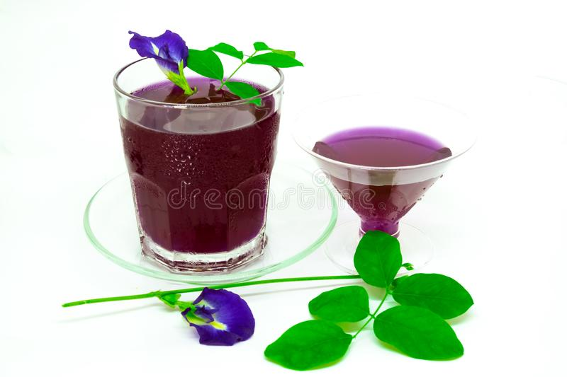 Thailand fresh healthy herbal beverage An-chan juice with lemon juice butterfly pea floweron white background. stock photo