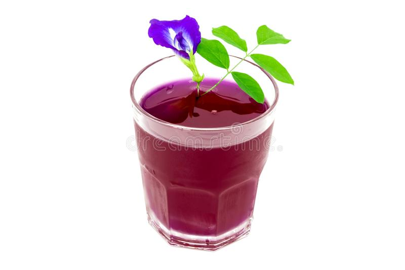 Thailand fresh healthy herbal beverage An-chan juice with lemon juice butterfly pea floweron white background. stock images