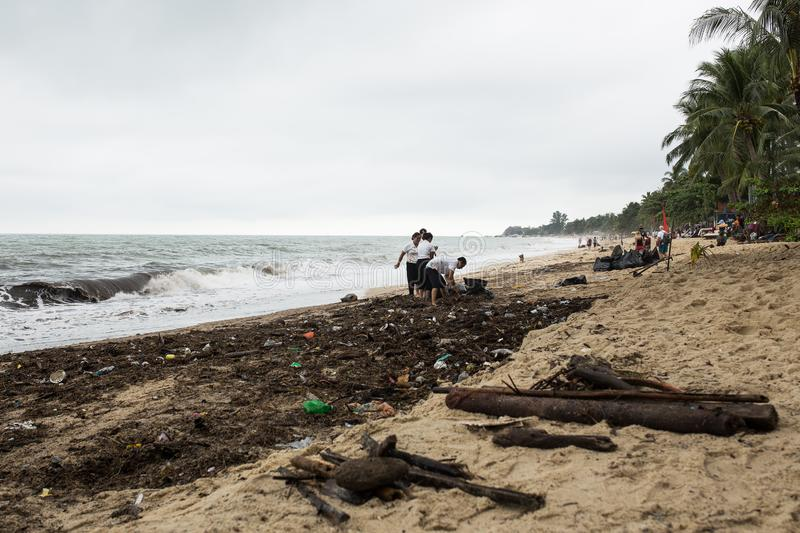 Thailand. Gulf of Thailand. Samui island. After the storm, people scavenge. Trash on the beach after a storm at sea. Thailand. Gulf of Thailand. Samui island stock photography