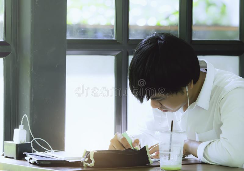 Thailand Hatyai. on 04/05/2019. Thailand studen is writing and learning in paper chees in cafe shop stock image