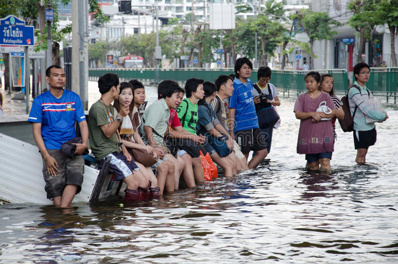 Thailand during its worst flood. BANGKOK THAILAND – NOVEMBER 13: People waiting of hight vehicles or boat during its worst flooding in decades is a major royalty free stock photography