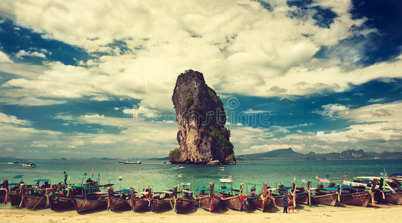 Thailand.Krabi province.Boats is moored in a turquoise lagoon of Phra Nang beach. stock photos