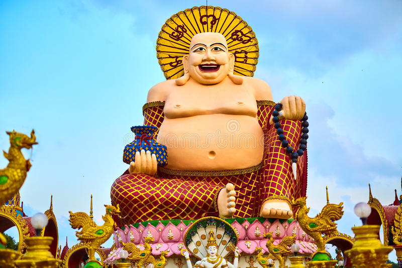 Thailand Landmark. Big Laughing Buddha Statue In Temple. Buddhist Religion. Thailand Landmark. Big Fat Laughing Buddha Statue ( Wealth Statue ) In Wat Plai Laem royalty free stock image