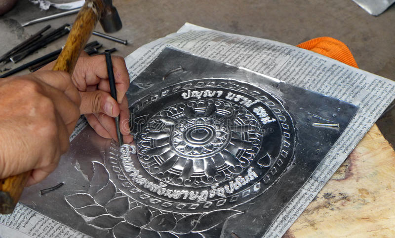 Thailand local silversmith at work. A photograph showing the work procedure of a local traditional silver workman in Chiang Mai, northern Thailand. Location is stock images