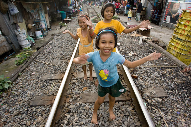 Thailand many peoples live along the railroad tracks or in slums. BANGKOK , THAILAND - NOVEMBER, 2005 : There are an estimated 7.3 million people that are royalty free stock image