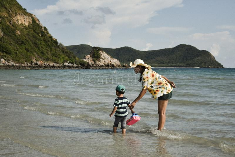 Mom and son playing together on the beach at Namsai beach Sattahip District, Thailand. stock photos