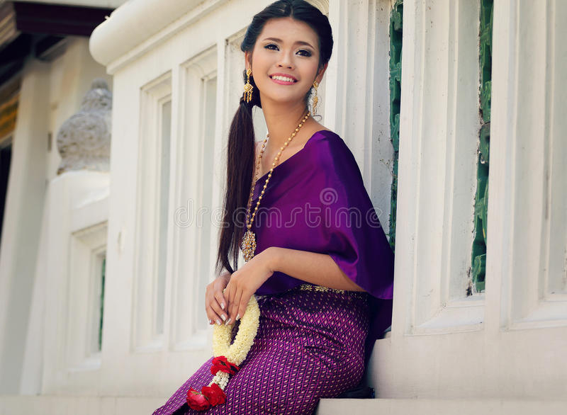 Thailand National Costume. Asian woman wearing thai traditional dress royalty free stock photography