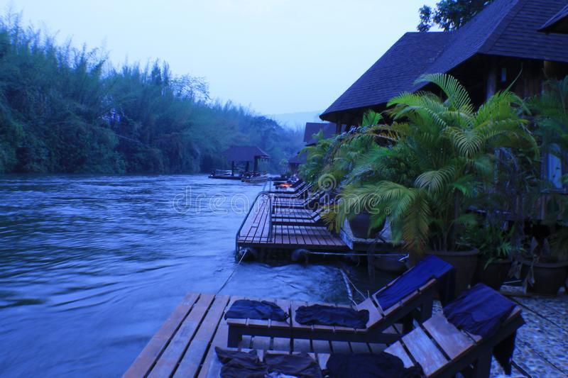 Nice vintage pool villa view in morning. Thailand nice vintage pool villa and flooding hotel at river stock photography