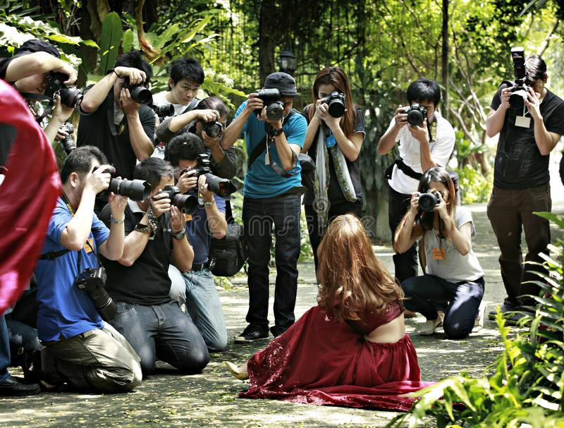 Thai Photographers. Thailand, 12 October: photography trips organized by Thailand many photographers swarm model photography on October 12, 2013 at Bangkok royalty free stock image