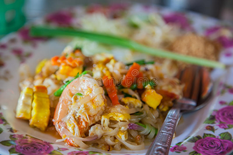 Thailands national dishes, stir-fried rice noodles royalty free stock photo