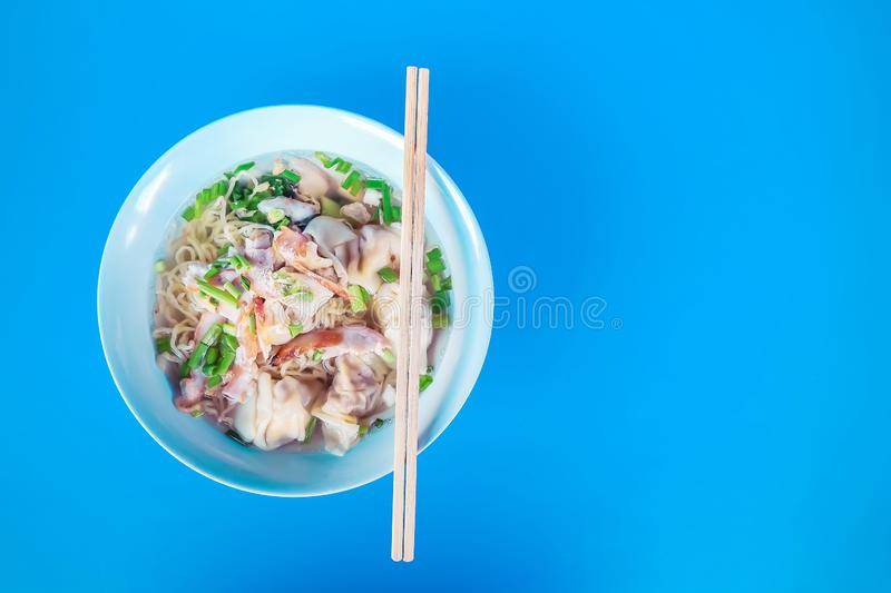 Thailand street food style noodle,bowl of thai style yellow noodle soup with pork royalty free stock photos