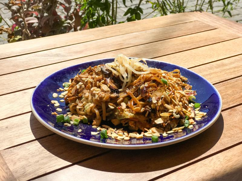 Thailand Style Vegetable Rice Noodle Pad Thai with Sauteed Cabbage, Carrot, Mushroom, Peanut, Egg and Ginger. Organic Traditional Food royalty free stock photo