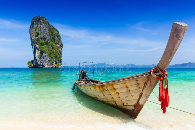 Thailand summer travel sea, Thai old wood boat at sea beach Krabi Phi Phi Island Phuket. royalty free stock images