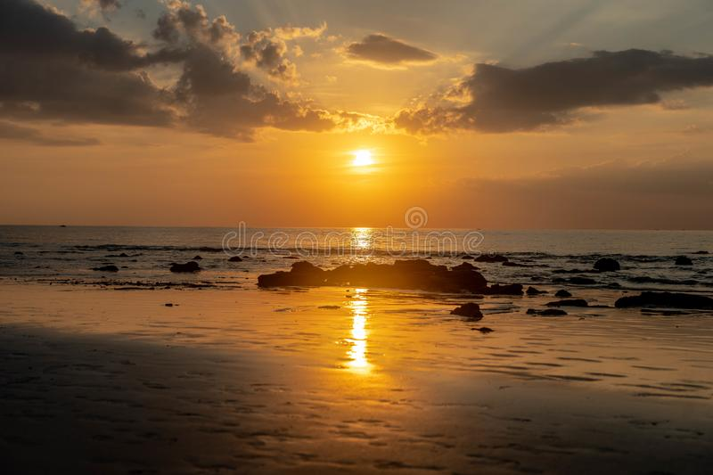 Thailand Sunset reflection on the beach royalty free stock image