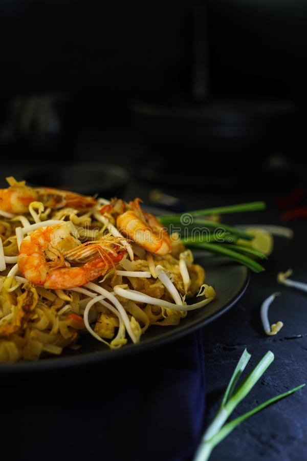 Thailand traditional cuisine, Pad thai, dried noodle, fried noodles, shrimp and seafood, street food, dark food photography stock image