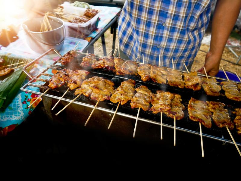 Thailand treditionlal food, Moo ping Thai word grilled pork, Food Scene of roasted pork thai style is grill royalty free stock images