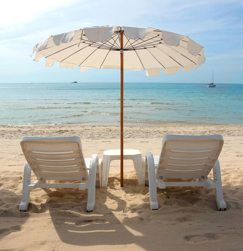 Thailand - White Sandy Beach with Loungers and Umbrellas royalty free stock photo