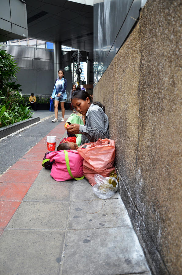 Thailand women begging in Bangkok. BANGKOK, THAILAND - JAN 21 2017: Thailand women begging on the overpass in Bangkok ,Thailand stock images