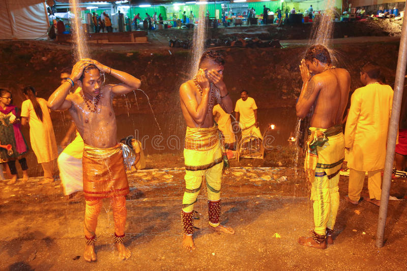 Thaipusam devotee cleansing themselve