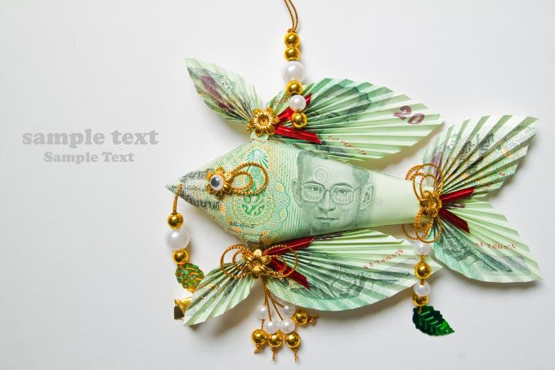 Thais bankbiljet twintig bad dat in een vis wordt gevouwen stock afbeelding