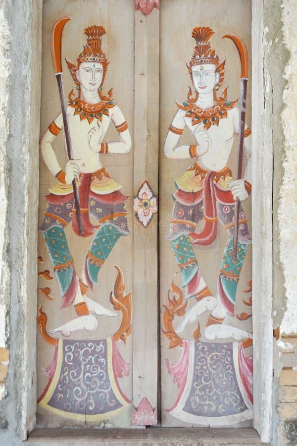 Thaise die ` s op de deur wordt geschilderd Wat Si Po Chai, het District van Na Haeo, Loei-Provincie, Thailand stock afbeeldingen