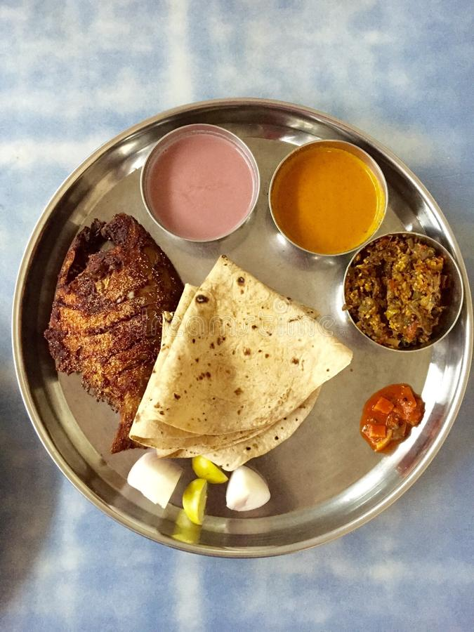Thali - An Indian Meal. Thali (meaning plate) is an Indian and Nepalese meal made up of a selection of various dishes. It simply means a round platter used to royalty free stock photo