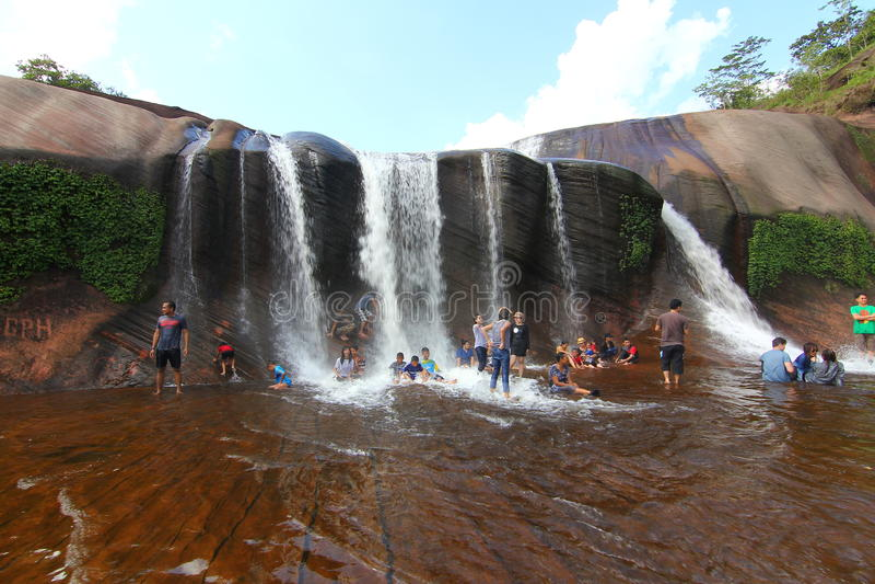 'Tham Phra' Waterfall Bungkan thailand. BUNGKAN, THAILAND - August 22, 2015: Unknown person, 'Tham Phra' Waterfall, People are playing waterfall. Bungkan 2015 royalty free stock images