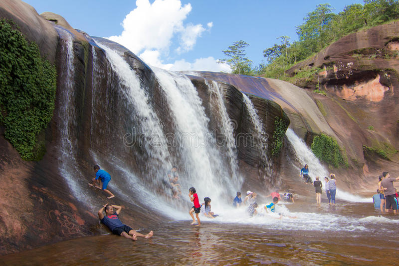 'Tham Phra' Waterfall Bungkan thailand. BUNGKAN, THAILAND - August 22, 2015: Unknown person, 'Tham Phra' Waterfall, People are playing waterfall. Bungkan 2015 royalty free stock image