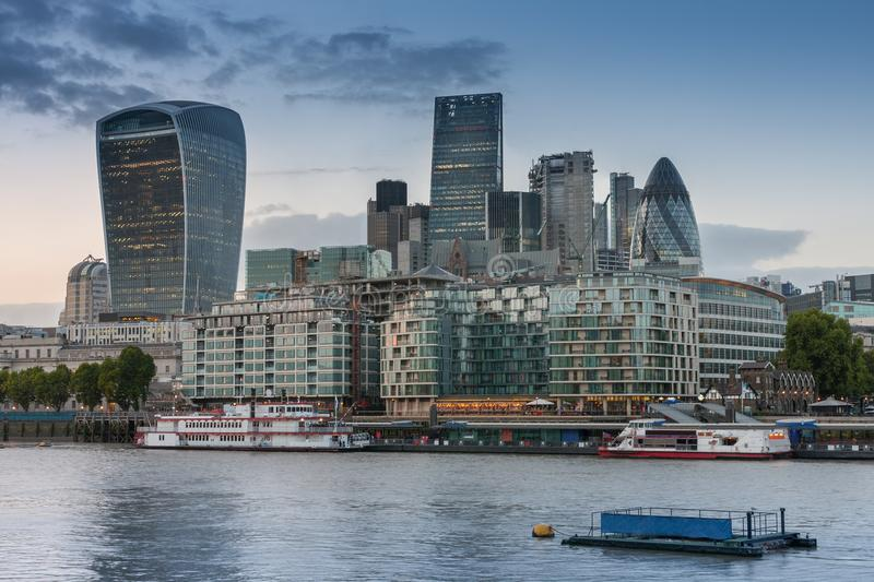 Thames embankment and london skyscrapers in City of London. At sunset time royalty free stock photo