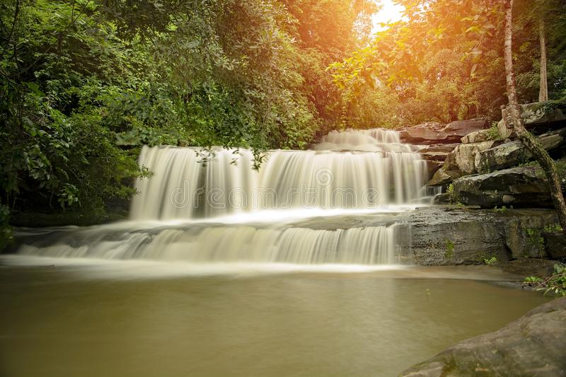 Than Thong Waterfall in Nong Khai Province, Thailand. It is a popular place to relax with family during the weekend.Add orange light to the beauty and stock images