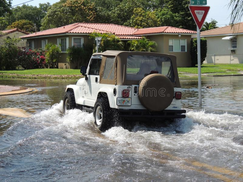 Thank God for a Jeep!. Flooded streets in Miami a low lying city prone to flash floods. A harbinger for global warming, Miami is the proverbial canary in the royalty free stock images