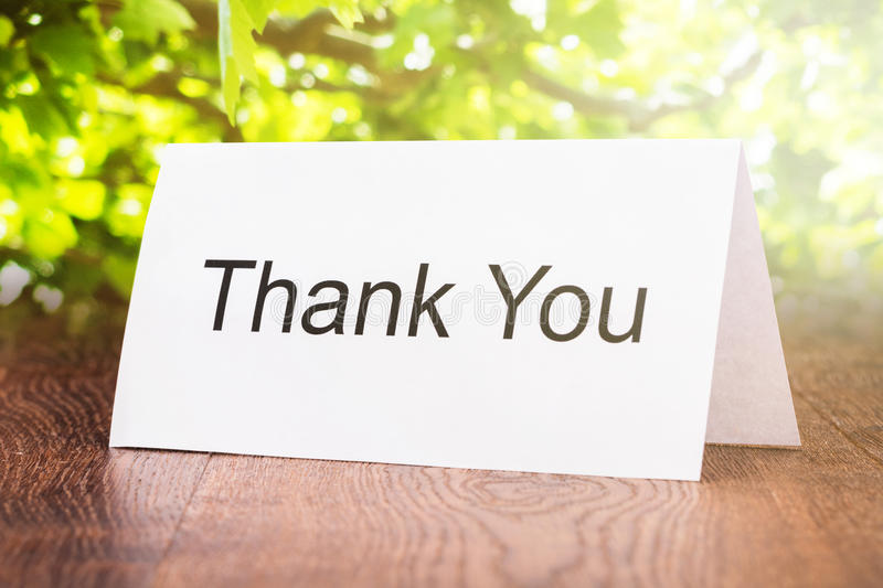 Thank You Card On Wooden Floor. Close-up Of Thank You Card On Wooden Floor stock photography
