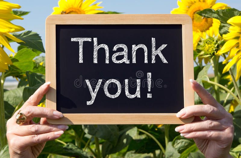 Thank you - chalkboard with flowers royalty free stock image
