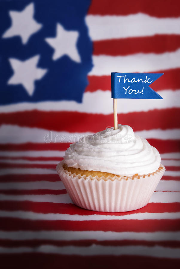 Thank You Cupcake. Cupcake with White Topping and Blue Flag with Thank You on it on an American Flag Background stock photo