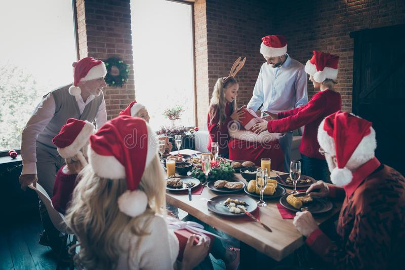 Thank you daddy. Photo of full harmony family gathering dinner table sharing x-mas presents getting out large santa pack. Thank you daddy. Photo of full harmony royalty free stock photos