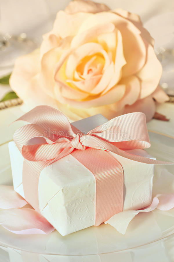 Thank you gift at wedding reception. Small thank you gift on plate at wedding reception royalty free stock images