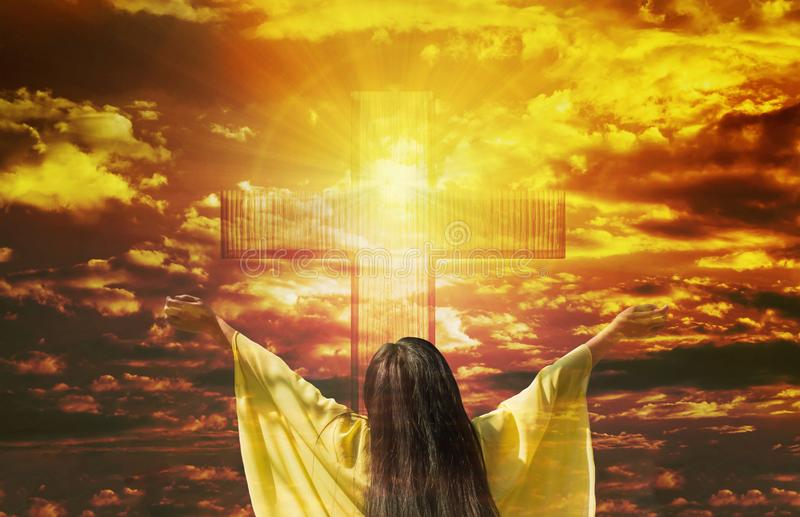 Thank you God, women back or rare view with big crucifix or cross on golden sky royalty free stock images