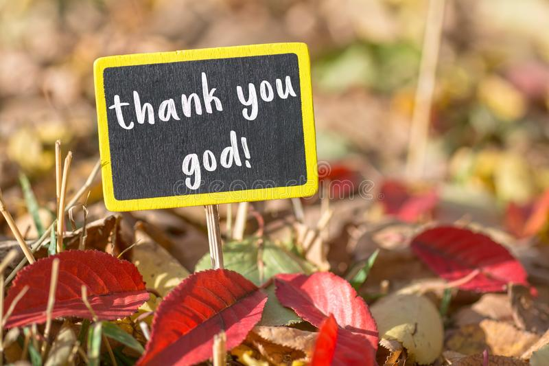 Thank you god sign. Thank you god wooden black sign in autumn leaves , motivation concept stock photos