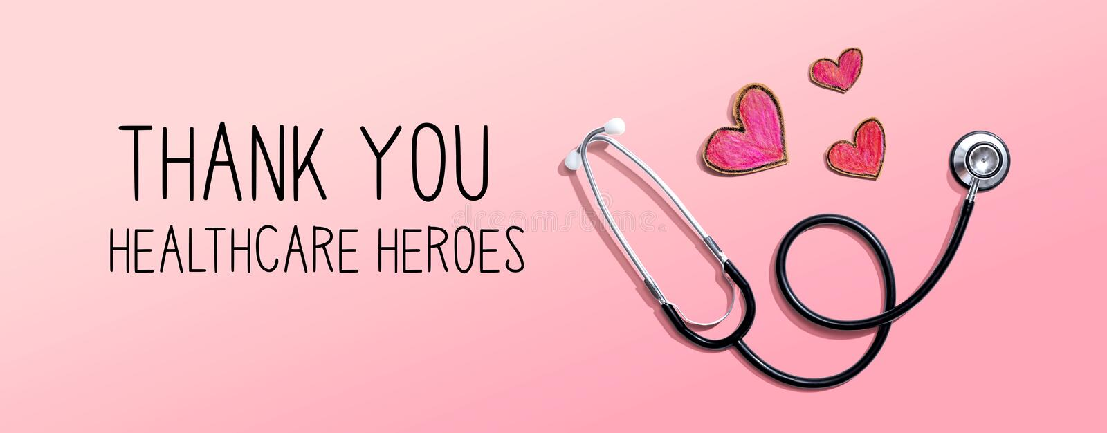 Thank You Healthcare Heroes message with stethoscope and hearts. Thank You Healthcare Heroes message with stethoscope and hand drawing hearts royalty free stock photo