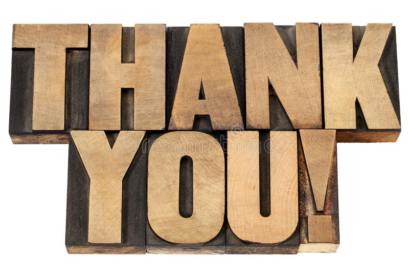 Thank you in letterpress wood type. Thank you exclamation - isolated text in vintage letterpress wood type royalty free stock photography