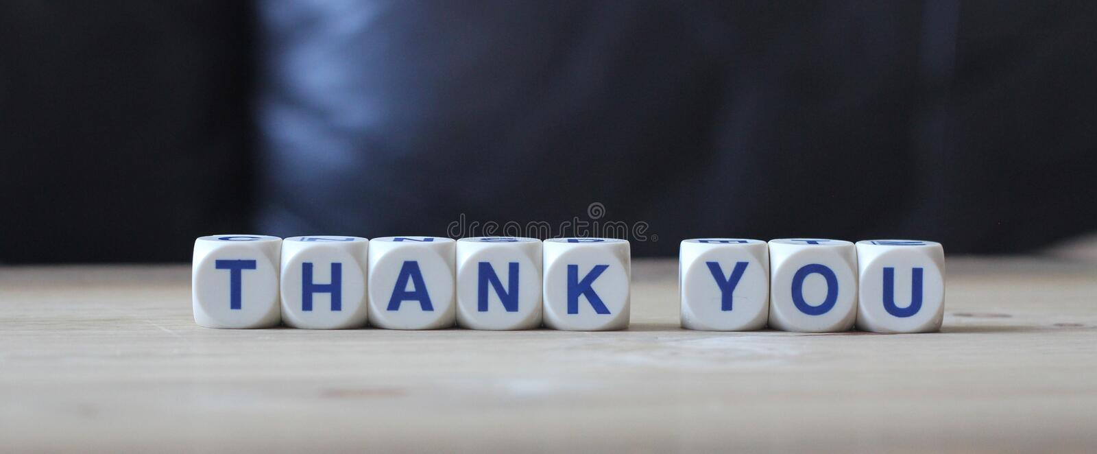 Thank you. Letters cube wordings on wood background stock image