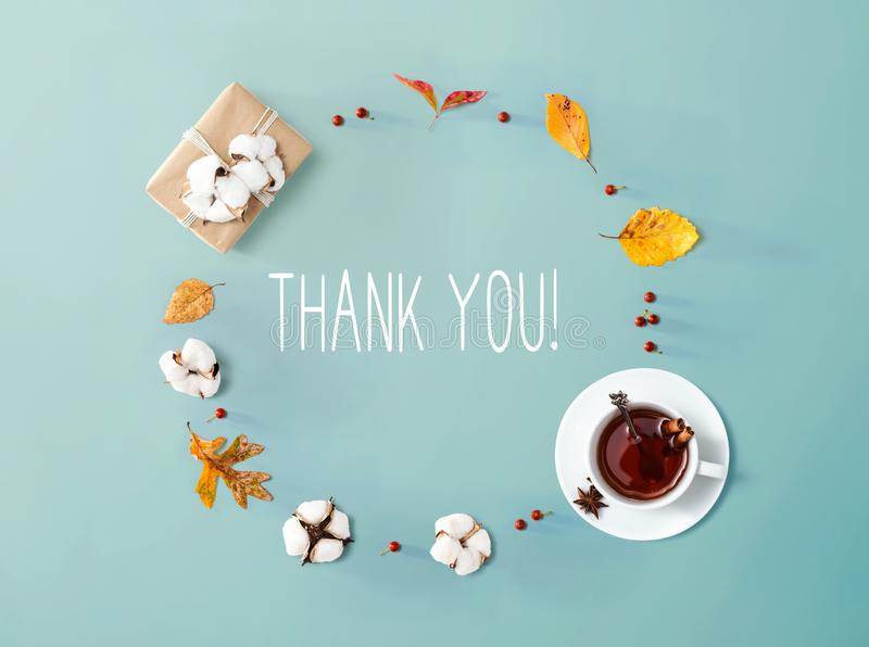 Thank you message with autumn leaves and tea royalty free stock photo