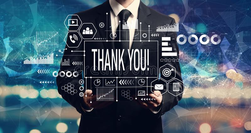 Thank you message with businessman holding a tablet royalty free stock image
