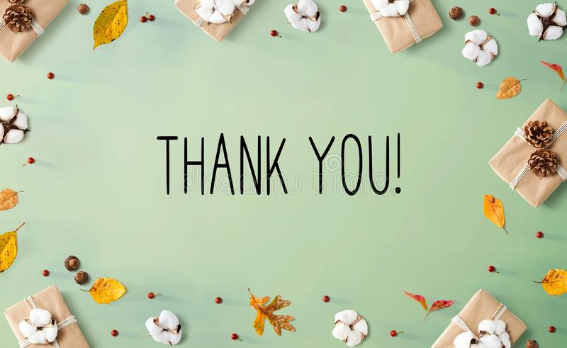 Thank you message with gift boxes with leaves royalty free stock images